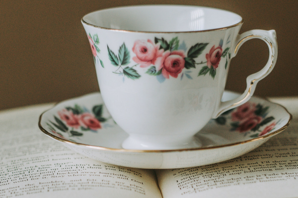 An image of a floral cup on a funeral ceremonies book, featured on the Blossom Ceremonies website to represent how Derren Gallo will guide you through your loved ones funeral ceremony.